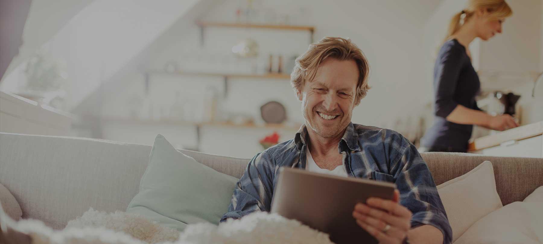 Smiling man using tablet